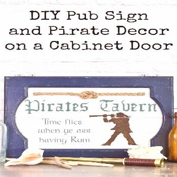 A cabinet door gets a fresh look as a pub sign and pirate decor to use as nautical wall decor for a