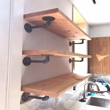 Floating Black Steel Pipe Shelving A simple, beautiful shelf.  For customers who wanted a lighter f