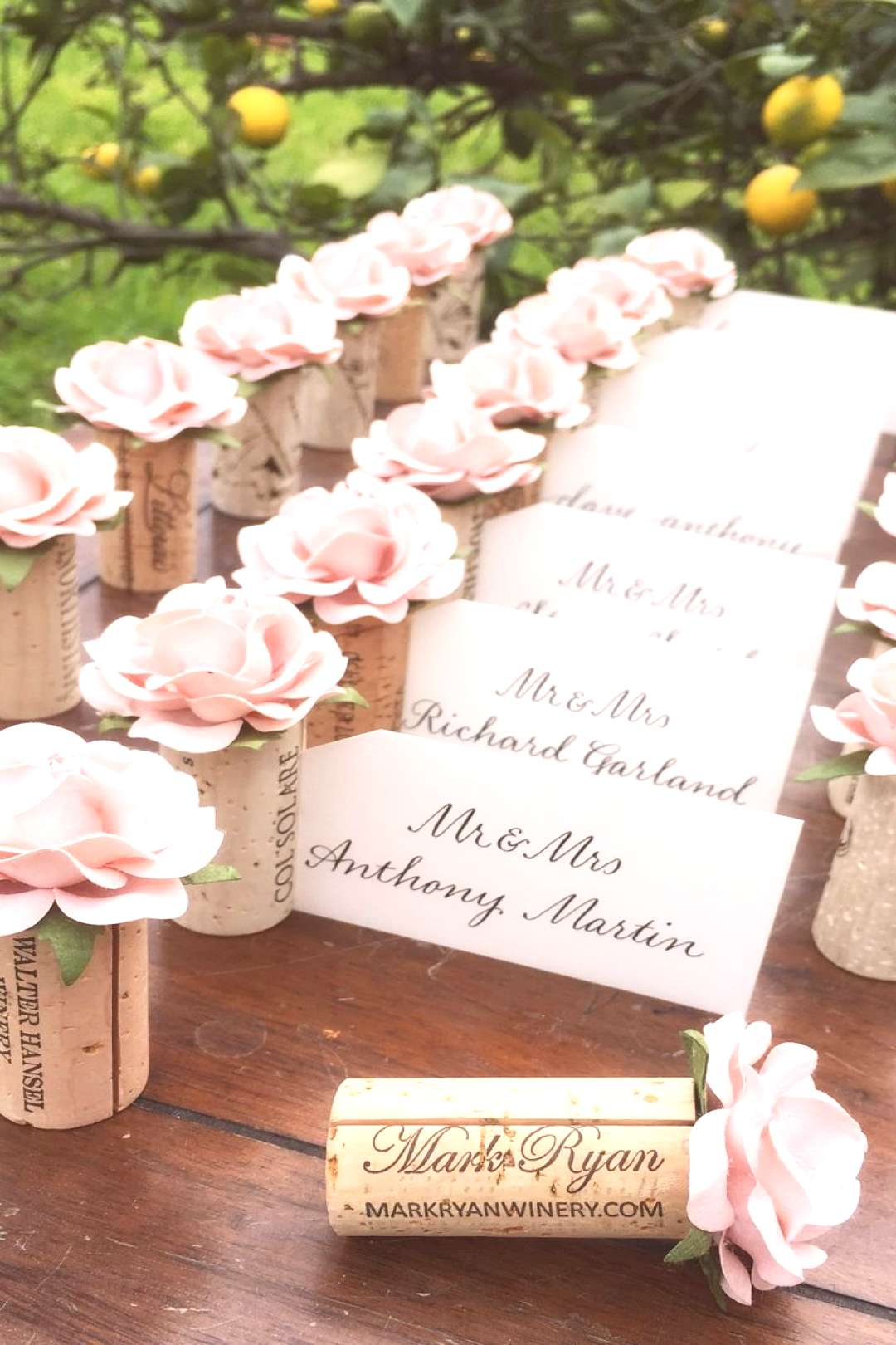 Blush Pink roses on wedding place card holders, a beautiful wedding reception place card table idea