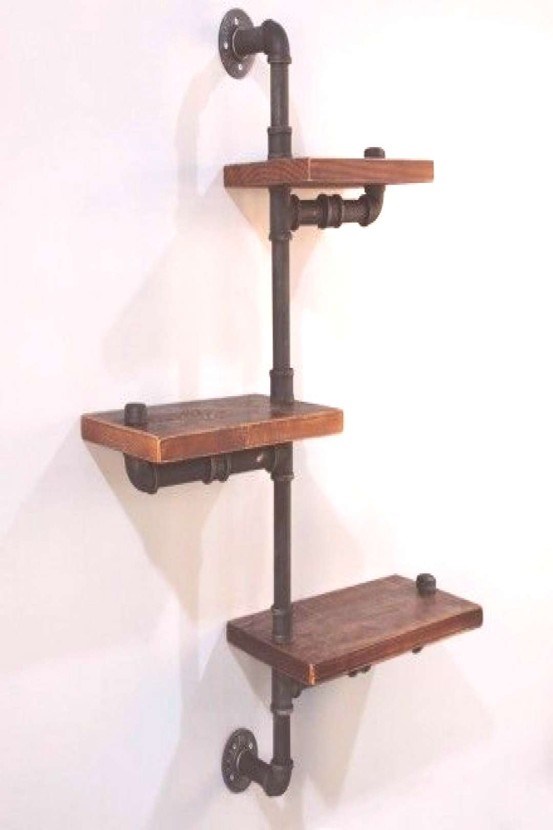 DIY Industrial Pipe Shelves Featuring a set of urban rustic floating pipe shelf that is perfect for