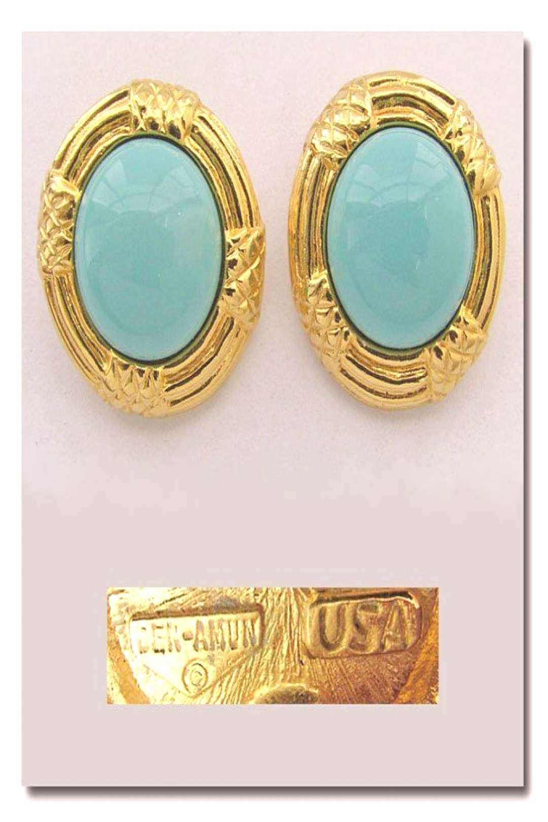 made of gold-plated metal with large turquoise glass cabochons. $27 includes US shipping. More pics