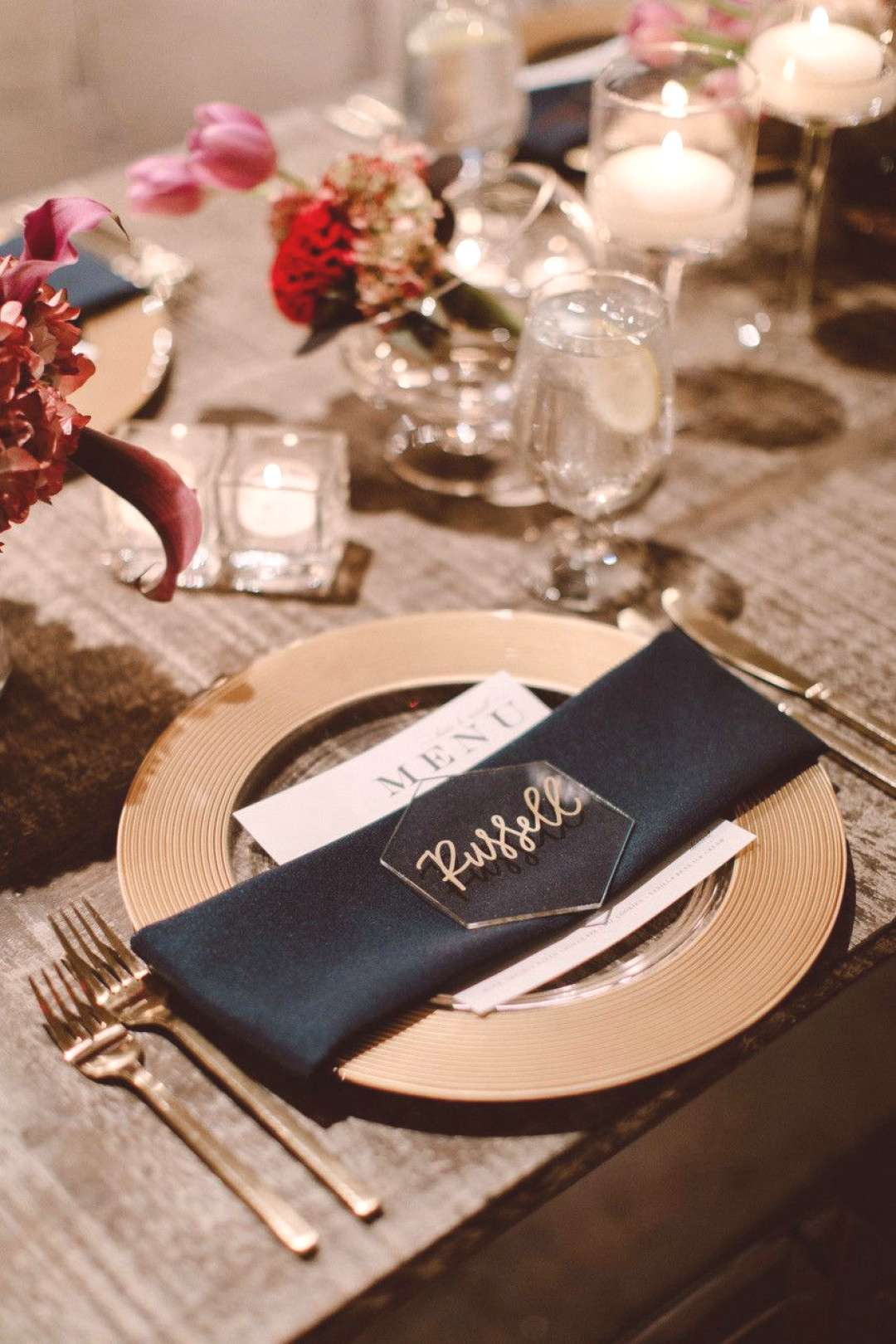 Pair your acrylic place cards with a darker napkin—an inky black linen, like the one seen here, a