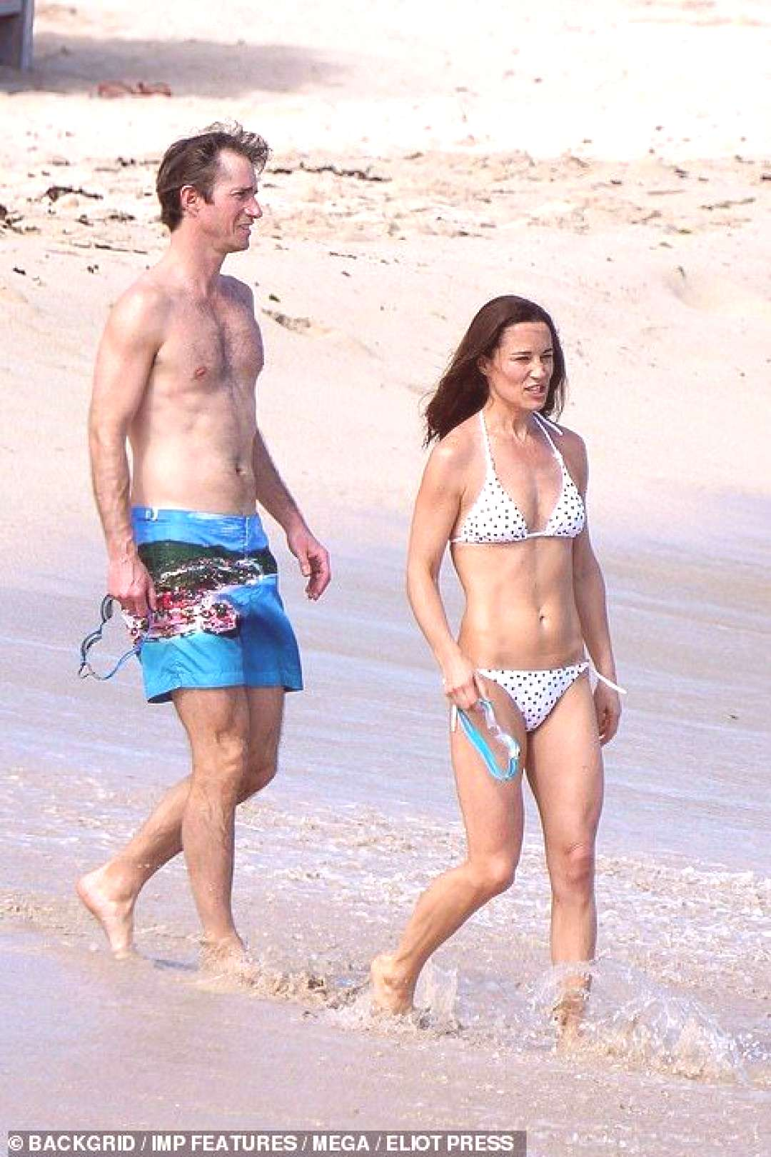 Pippa and James heading into the waves...