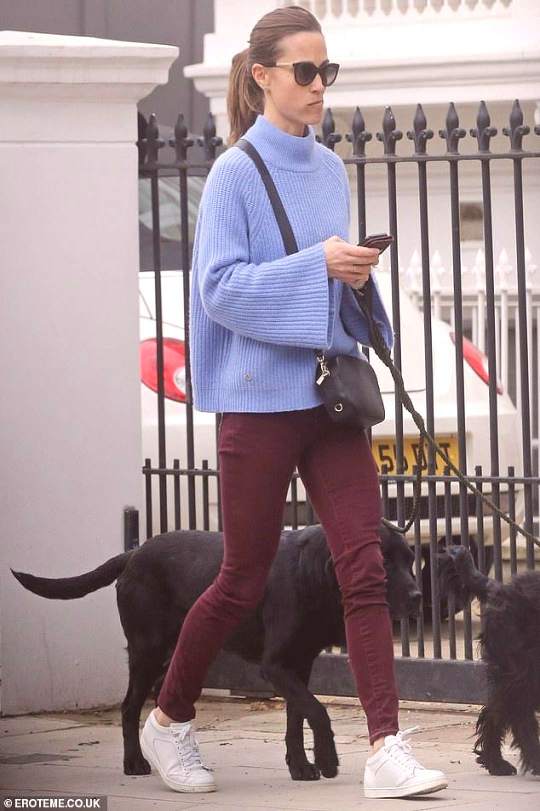 Pippa plumped for a favourite pair of casual white Jimmy Choo trainers for the stroll...