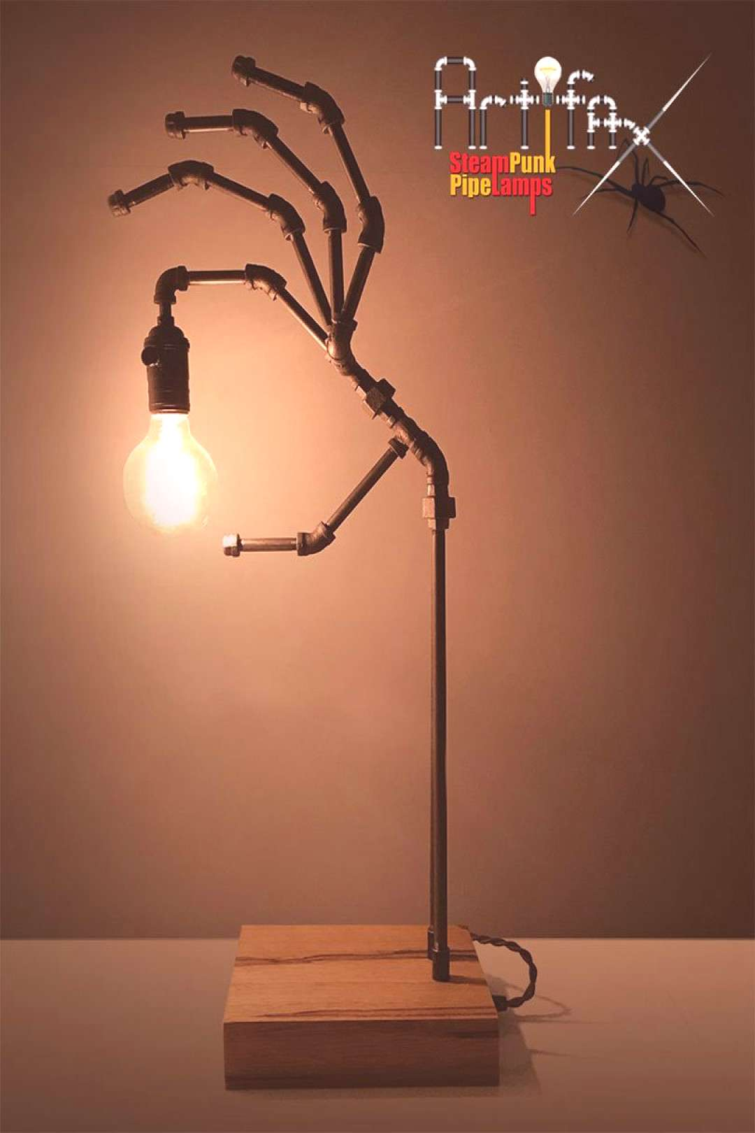 Steampunk Human Hand Lamp of exceptional quality built from black iron pipe fittings with the desig